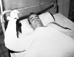 McCain in hospital bed in Vietnam